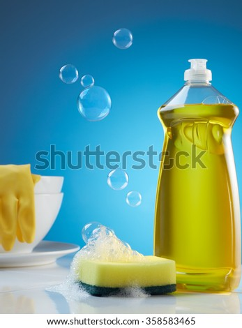 dish washing products with bubbles, soap and crockery - stock photo