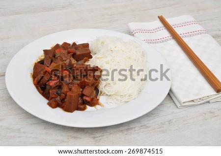 Dish with chopsticks - stock photo