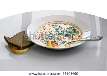dish with fish soup on a gray background