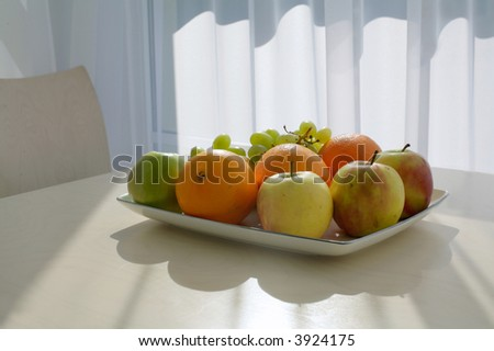 dish with fresh healthy fruit - stock photo