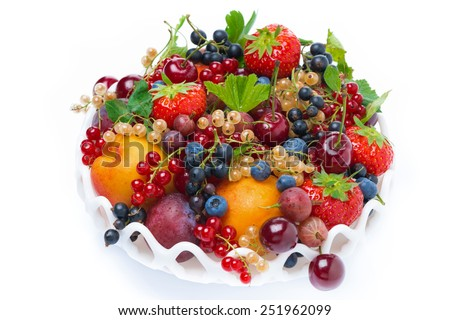 dish with fruit and seasonal berries, top view, isolated on white - stock photo