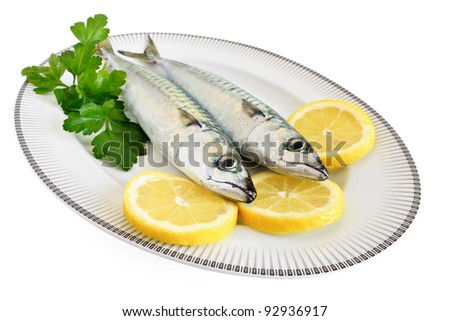 dish with mackerel with lemon and parsley isolated on white background with clipping path
