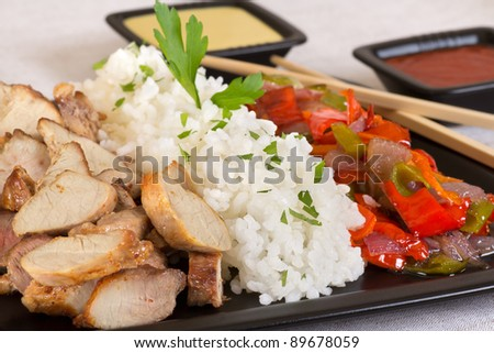 Dish with meat, rice and vegetables