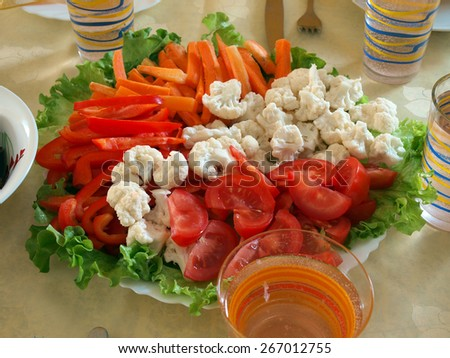 Dish with mixed different vegetable salad close up    - stock photo