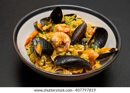 dish with paella  and seafood - stock photo