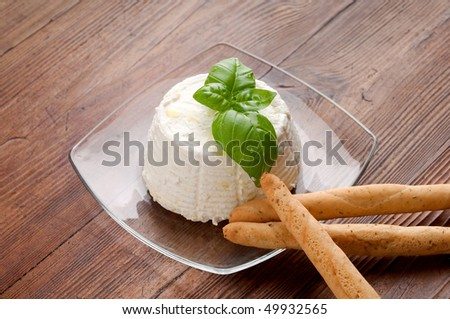 dish with ricotta and breadstick - stock photo