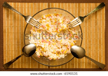 Dish with salad and for four persons. - stock photo