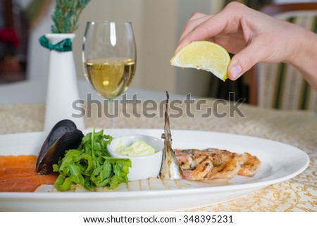 dish with seafood and white sause on the table in the restaurant