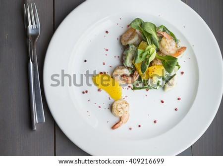 dish with shrimp and orange - stock photo