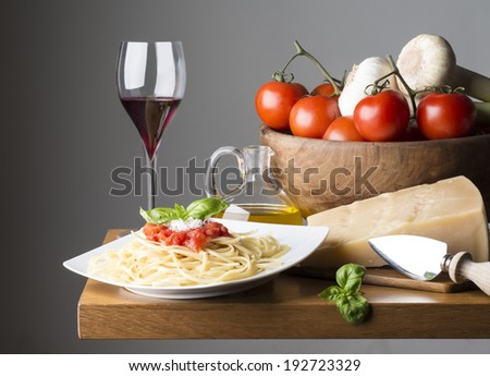 dish with spaghetti and ingredients on the wooden table - stock photo