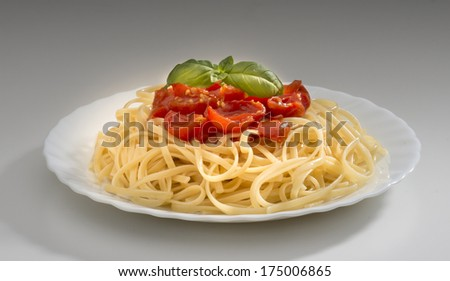 dish with spaghetti and tomato sauce