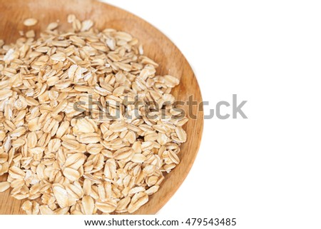 dish wood with oats flakes pile