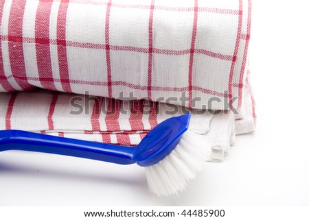 Dishes cloth with washing-up brush