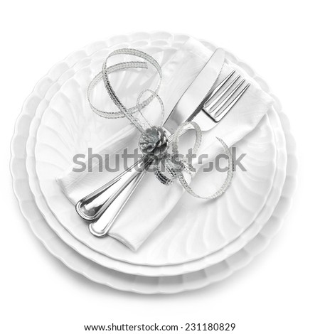dishes, cutlery and napkin isolated on white background - stock photo