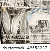 Dishes in the open dishwasher , Inside , clean dishware. - stock photo