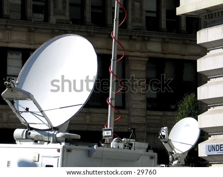 Dishes of Media Vans in Union Square, NYC - stock photo