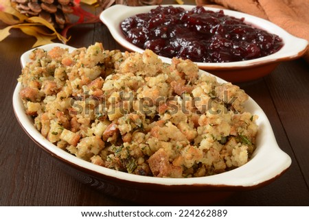 Dishes of turkey stuffing and chunky cranberry sauce - stock photo