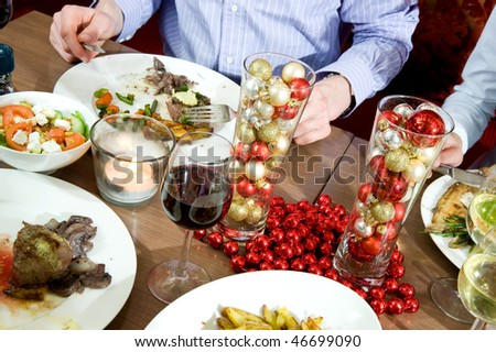Dishes on a restaurant table, decorated for Christmas - stock photo