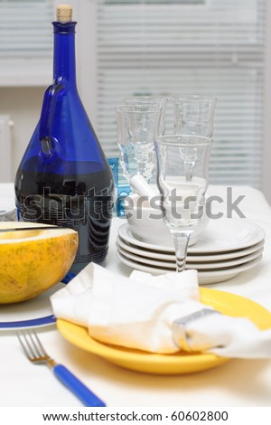 Dishes on the table in the blue-yellow color