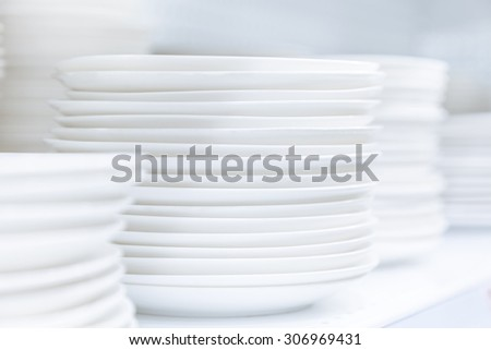Dishes Plates stacked white and clean tableware - stock photo