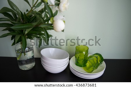 Dishes with flowers  - stock photo