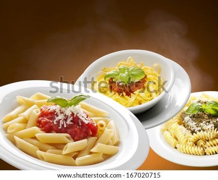 dishes with pasta isolated on background - stock photo