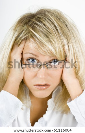disheveled, distraught young blonde girl with glasses - stock photo