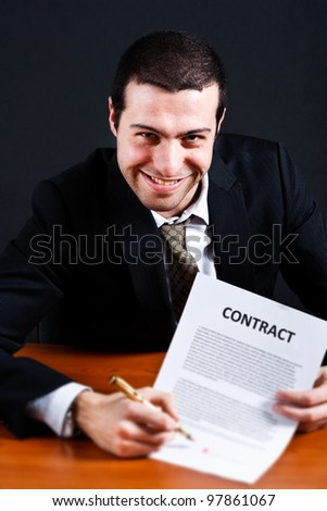 Dishonest businessman asking for signature on a contract