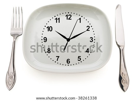 Dishware and clock. Concept restrictions in food - stock photo