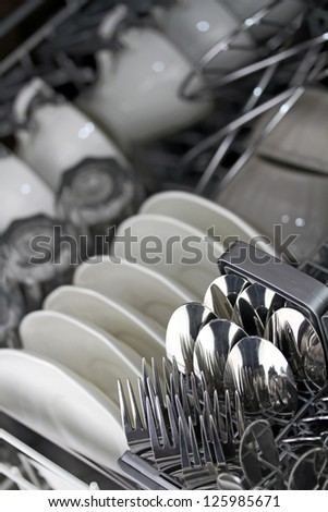 Dishwasher after cleaning process - stock photo