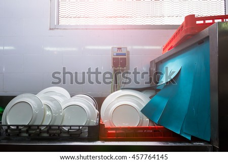 Dishwasher cleaning with heat - stock photo