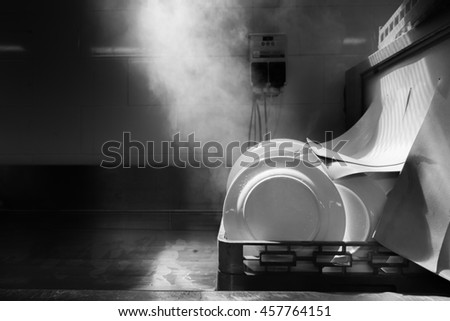 Dishwasher cleaning with heat , photo with monocrome filter - stock photo