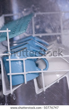 Dishwasher in action - stock photo