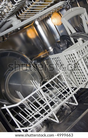 Dishwasher interior with pots, pans and cutlery - stock photo