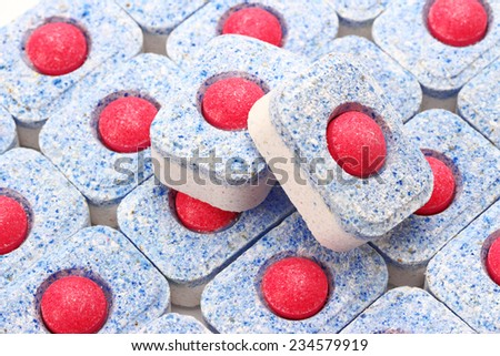 Dishwasher tablets close-up, background - stock photo