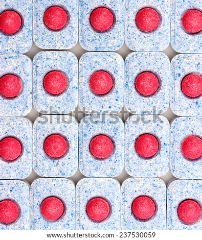 Dishwasher tablets close-up, top view, background - stock photo