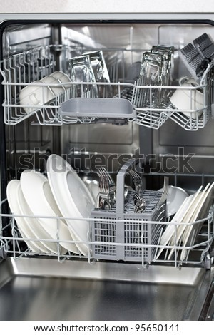 dishwasher clipart black and white. dishwasher with white plates and steel cutlery clipart black p