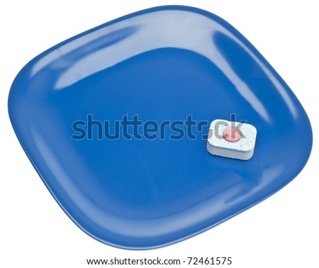 Dishwashing Tablet and Clean Plate Isolated on White with a Clipping Path. - stock photo