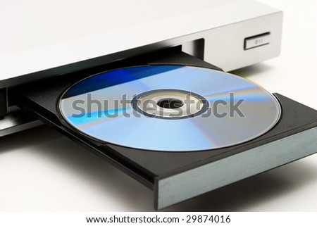Disk drive in DVD player on a white background. Light shade.