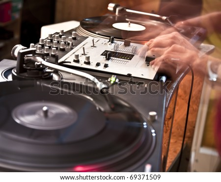 Disk jockey in motion - stock photo