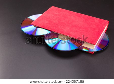 Disks in book - stock photo