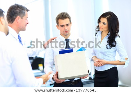 dismissed businessman carrying box - stock photo