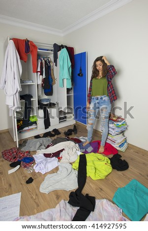 Disorder and mess at home. Cheerful young girl. - stock photo