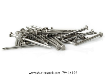 DISORDERED PILE OF WOOD NAILS ISOLATED ON WHITE, STUDIO SHOOT