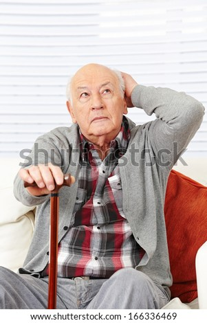 Disoriented demented old senior citizen man trying to remember - stock photo
