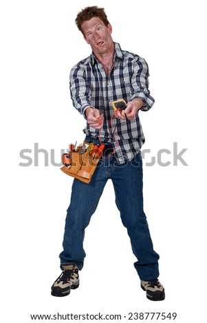 Disoriented man holding a multimeter - stock photo