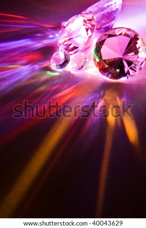 Dispersion of light through crystals into rainbow colors - stock photo