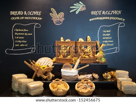 Display of bread variety on shelves in interior - stock photo