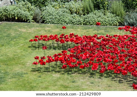 Display of ceramic poppies commemorating the centenary of the start of the First World War, with the poppies representing military personnel killed during the War. - stock photo