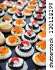 Display of colorful individual gourmet appetizers on a buffet table at a banquet or upmarket catered event - stock photo